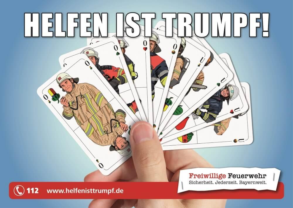 """Der Landesfeuerwehrverband Bayern und die bayerischen Feuerwehren sprechen eine Bitte zur Unterstützung ihrer neuen Kampagne """"Helfen ist Trumpf"""" aus."""